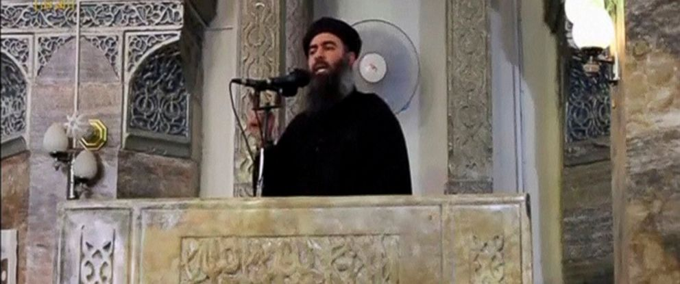 PHOTO: A man purported to be the reclusive leader of the militant Islamic State Abu Bakr al-Baghdadi marks what would have been his first public appearance, at a mosque in the centre of Mosul, according to a video recording posted on July 5, 2014.