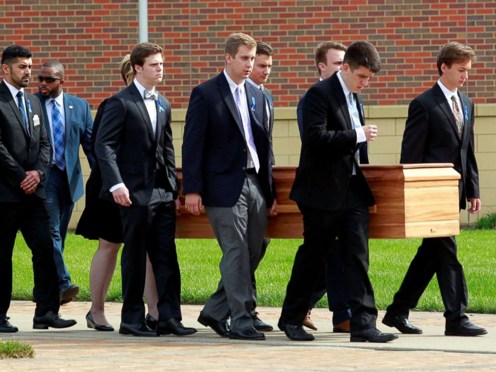 PHOTO: Otto Warmbiers casket is carried to the hearse followed by his family and friends after a funeral service for Warmbier, who died after his release from North Korea detention in a coma, at Wyoming High School in Wyoming, Ohio, June 22, 2017.