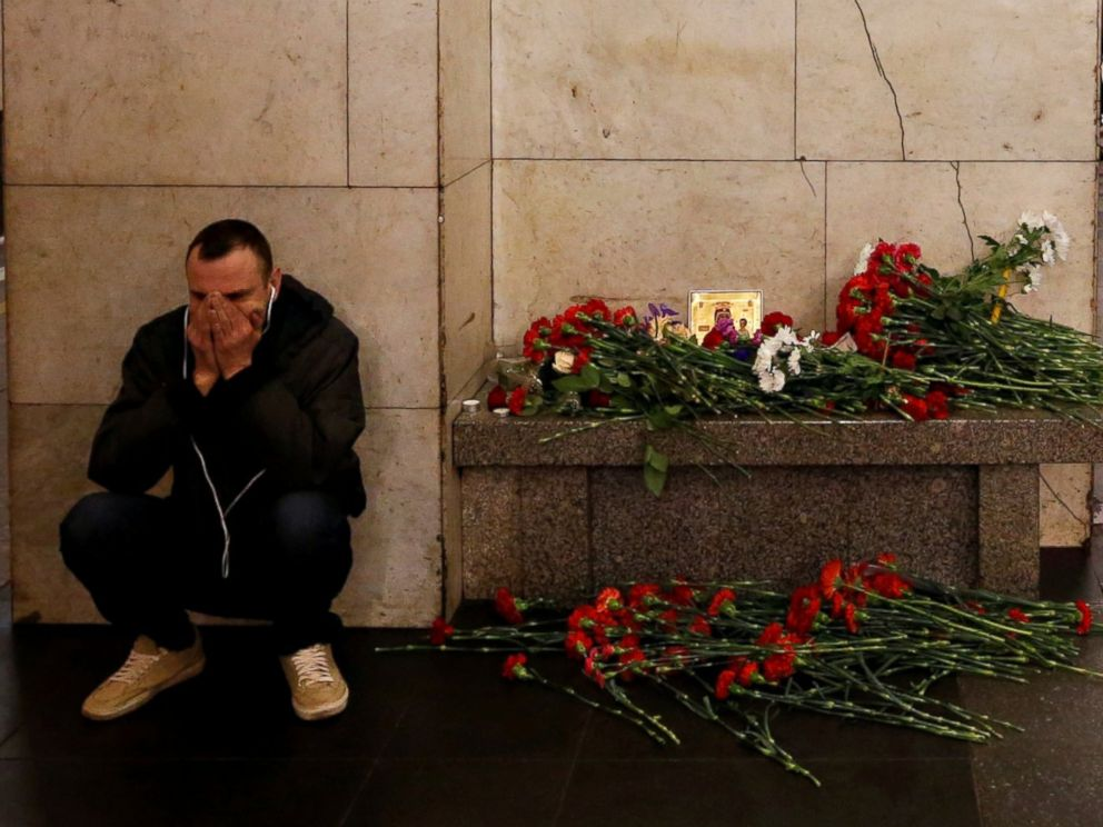 PHOTO: A day after a deadly blast in the St. Petersburg metro, a man reacts next to a memorial site for the victims at Tekhnologicheskiy institut metro station, Apr. 4, 2017, in St. Petersburg, Russia.