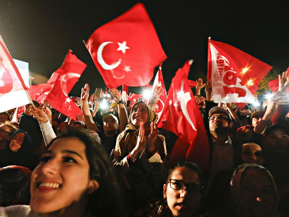 PHOTO: Supporters of Turkish President Recep Tayyip Erdogan celebrate victory in the referendum vote to amend the constitution, April 16, 2017, in Istanbul.