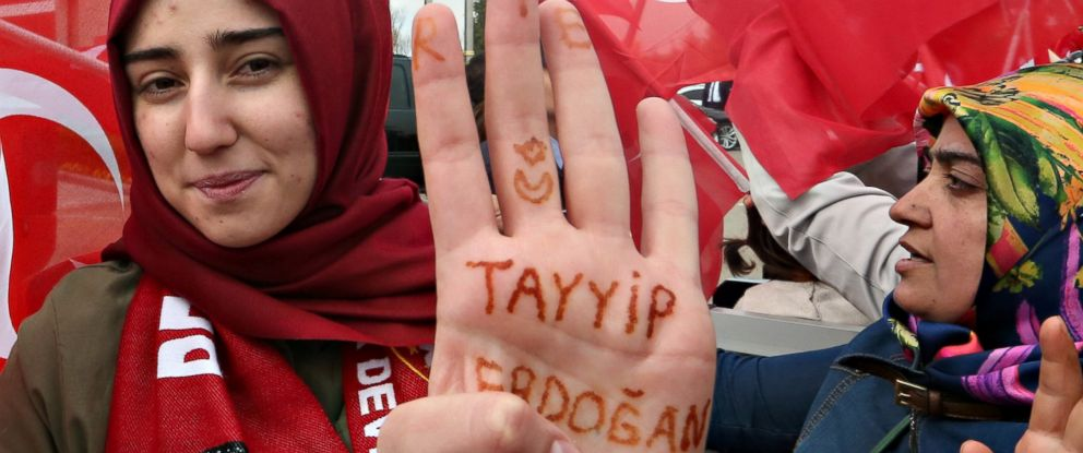PHOTO: A woman shows the name of Turkeys president written on her palm as she waits for the arrival of President Tayyip Erdogan at Esenboga Airport, April 17, 2017, in Ankara, Turkey.