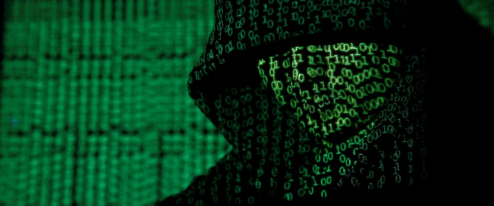 PHOTO: A projection of cyber code on a hooded man is pictured in this illustration picture taken on May 13, 2017.