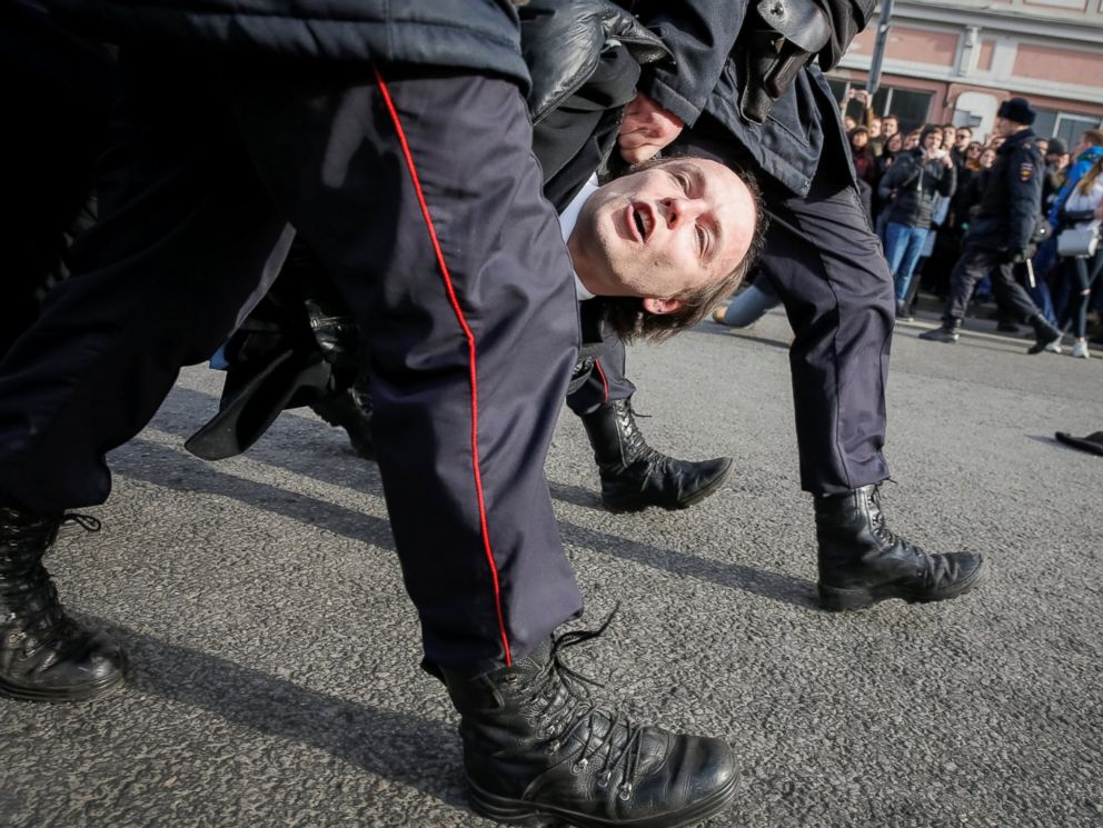 PHOTO: Law enforcement officers detain an opposition supporter during a rally in Moscow, Russia, March 26, 2017.