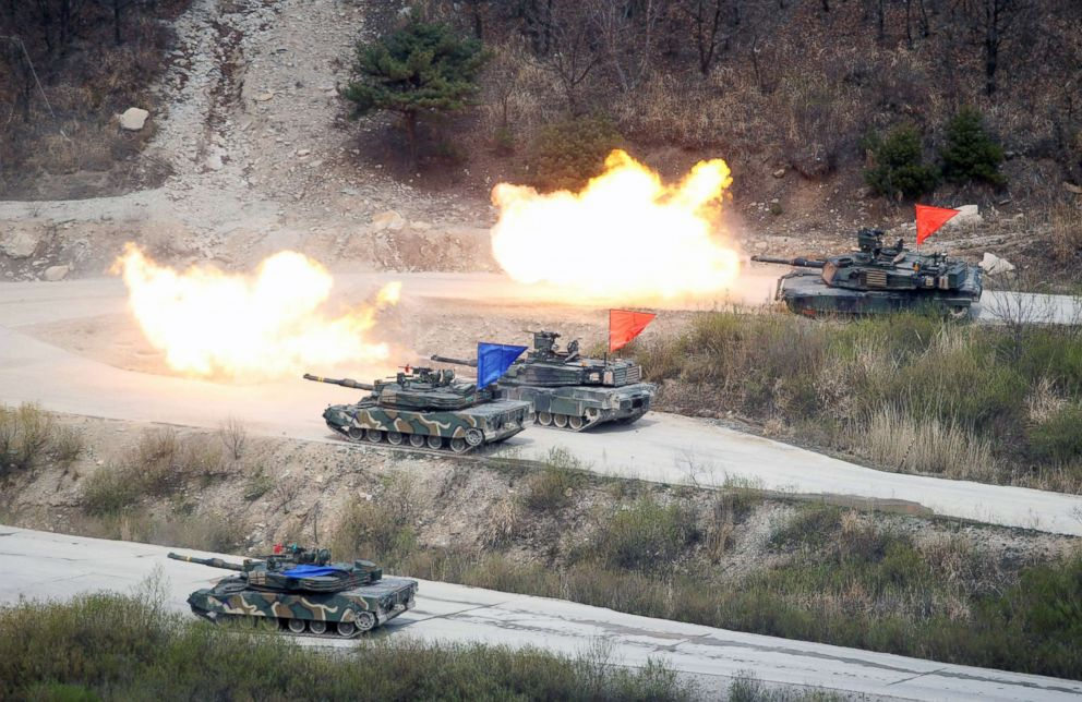 South Korean Army K1A1 and U.S. Army M1A2 tanks fire live rounds during a U.S. South Korea joint live-fire military exercise, at a training field, near the demilitarized zone, separating the two Koreas in Pocheon, South Korea in this April 21, 2017.
