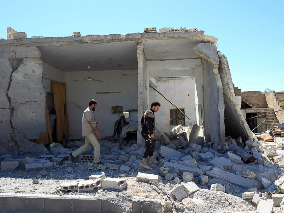 PHOTO: Civil defense members inspect the damage at a site hit by airstrikes in the town of Khan Sheikhoun in rebel-held Idlib, Syria, April 5, 2017.