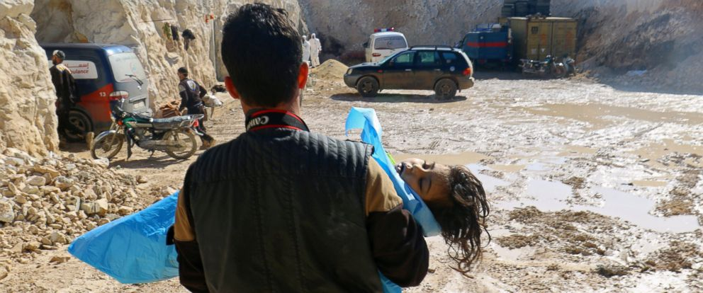 PHOTO: A man carries the body of a dead child after what rescue workers described as a suspected gas attack in the town of Khan Sheikhoun in rebel-held Idlib, Syria, April 4, 2017.