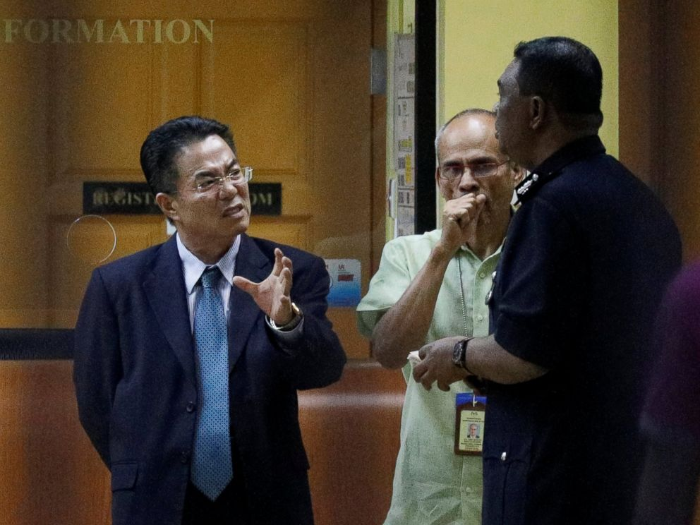 PHOTO: North Koreas ambassador to Malaysia, Kang Chol, left, speaks with police at the morgue at Kuala Lumpur General Hospital where Kim Jong Nams body is held for autopsy in Kuala Lumpur, Malaysia Feb. 15, 2017.