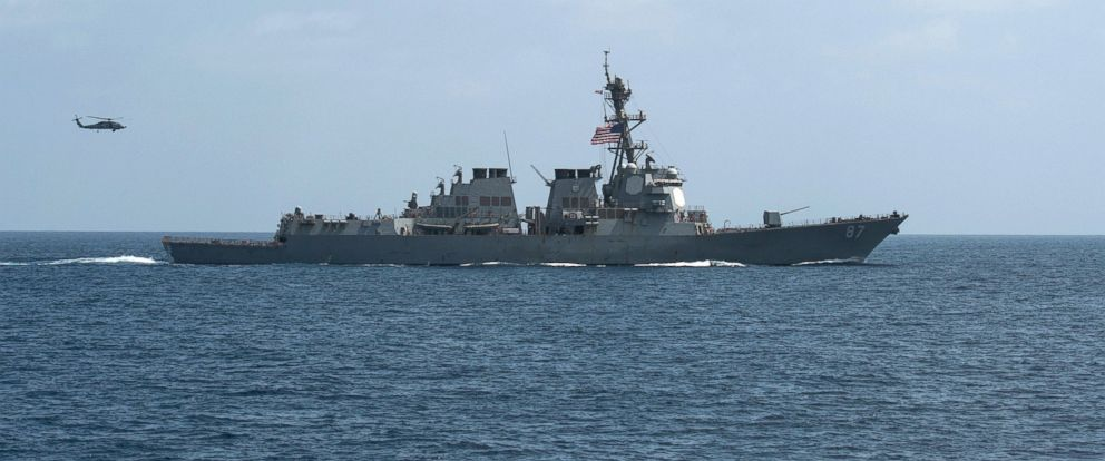 PHOTO: The guided-missile destroyer USS Mason conducts divisional tactic maneuvers as part of an exercise in the Gulf of Oman, September 10, 2016.