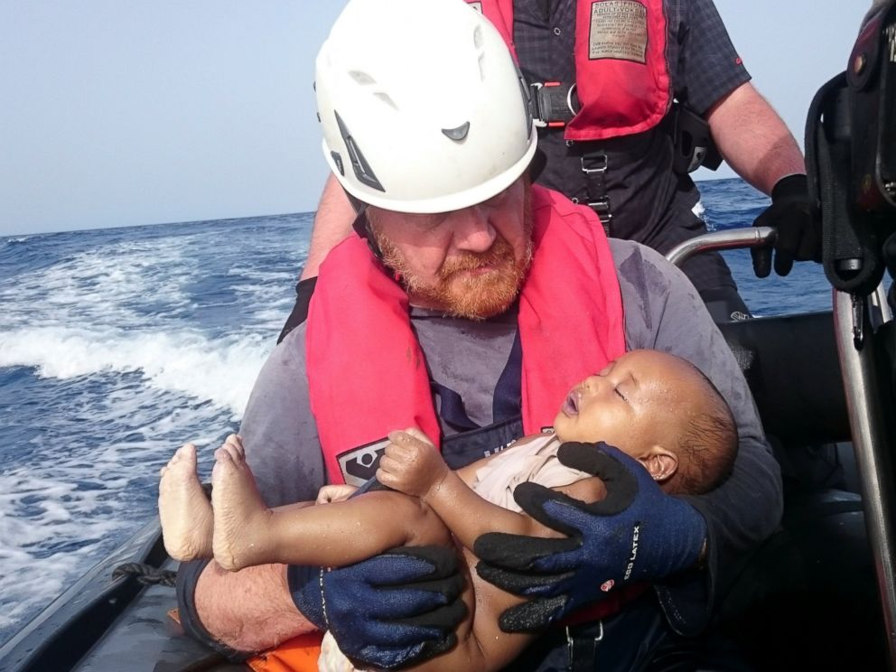 PHOTO: German rescuer from the humanitarian organization Sea-Watch holds a drowned migrant baby, off the Libyan coast on May 27, 2016.