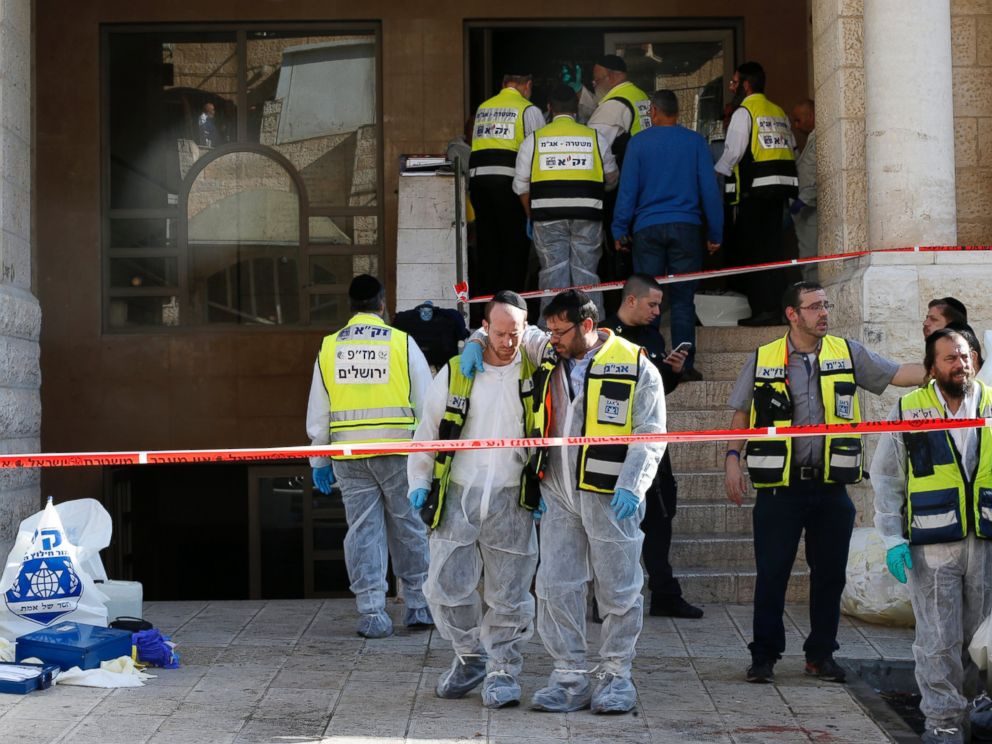 PHOTO: Israeli emergency personnel stand at the scene of an attack at a Jerusalem synagogue Nov. 18, 2014.