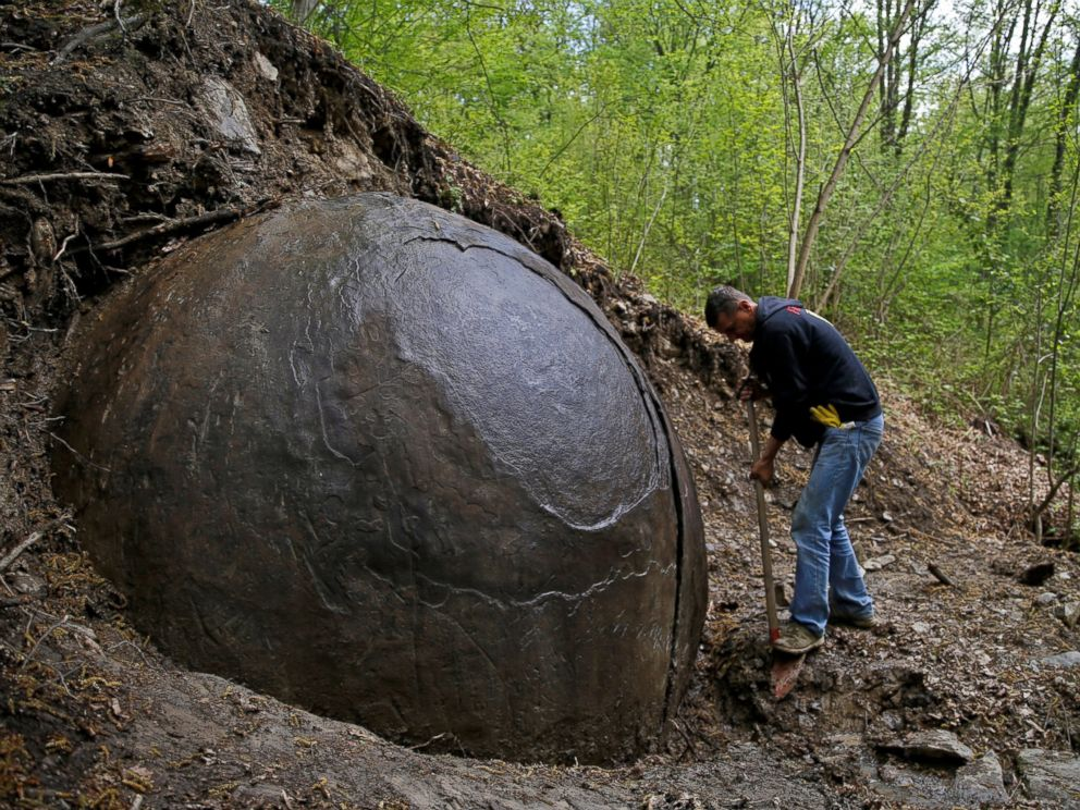 PHOTO: Suad Keserovic cleans a stone ball in Podubravlje village near Zavidovici, Bosnia and Herzegovina, April 11, 2016.