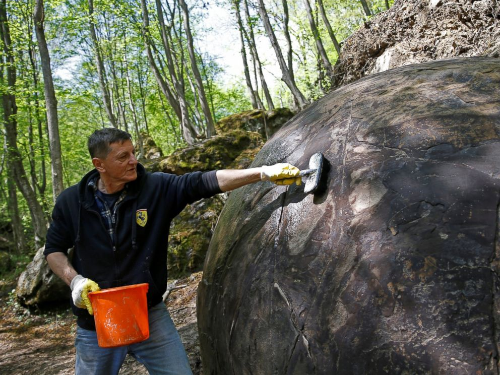 PHOTO: Suad Keserovic cleans a stone ball in Podubravlje village near Zavidovici, Bosnia and Herzegovina April 11, 2016.