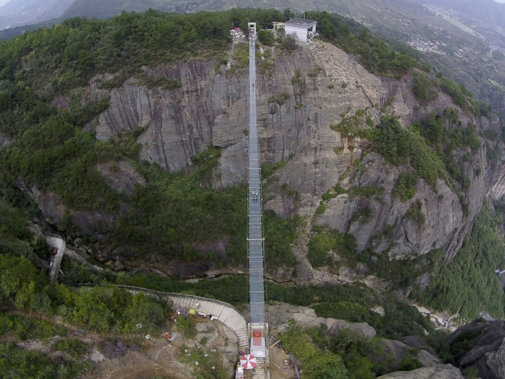 PHOTO: An aerial view shows a glass suspension bridge at the Shiniuzhai National Geo-park in Pinging county, Hunan province, China, Sept. 24, 2015.
