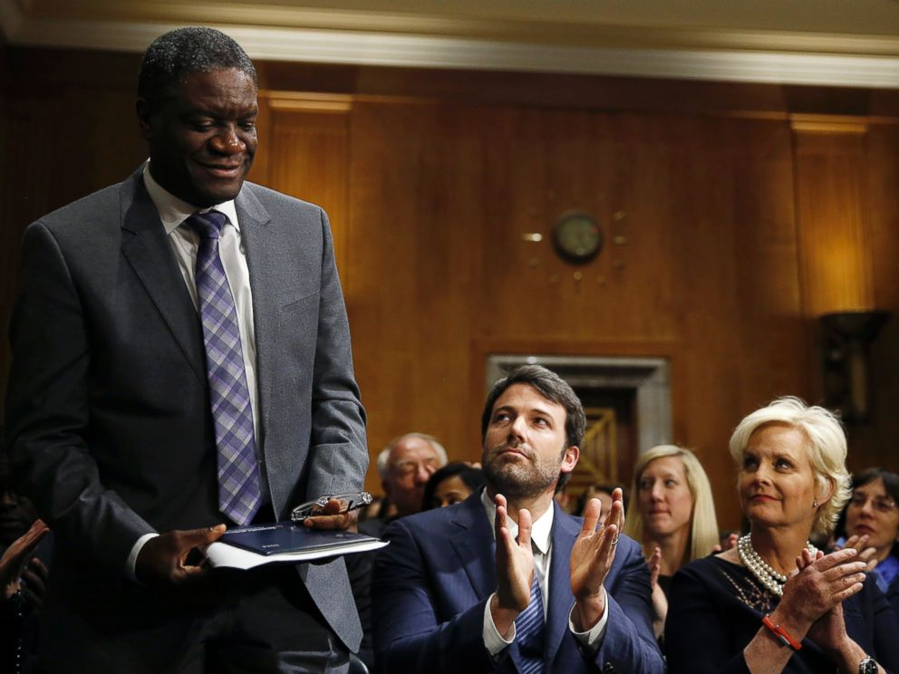 PHOTO: Actor, writer and director Ben Affleck (C) and Cindy McCain (L), applaud Denis Mukwege, (L), Medical Director of the Panzi Hospital in the Congo, at the Senate Foreign Relations Committee on Capitol Hill in Washington Feb. 26, 2014.