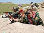 PHOTO: Iraqi Kurdish female fighter Haseba Nauzad, 24, and Yazidi female fighter Asema Dahir, 21, aim their weapon during a deployment near the frontline of the fight against Islamic State militants in Nawaran near Mosul, Iraq, April 20, 2016.