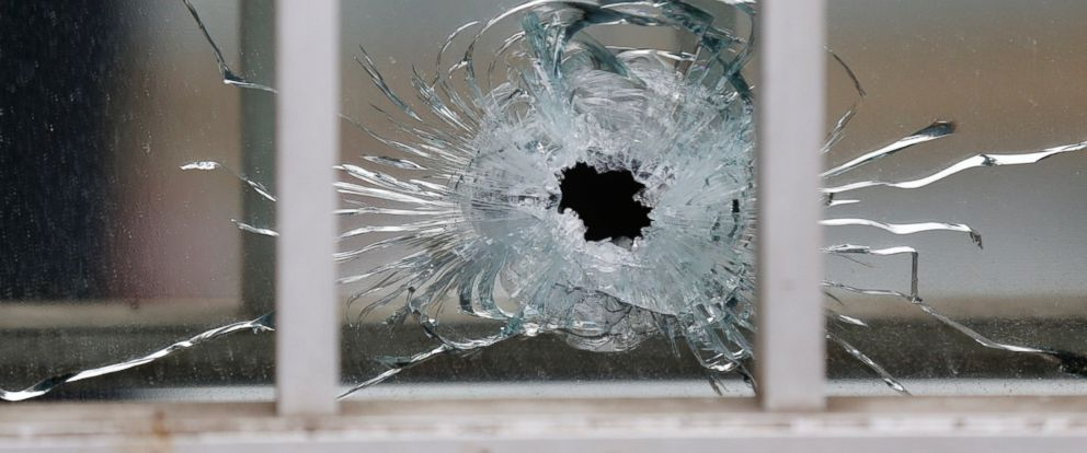 PHOTO A Bullets Impact Is Seen On Window At The Scene After Shooting