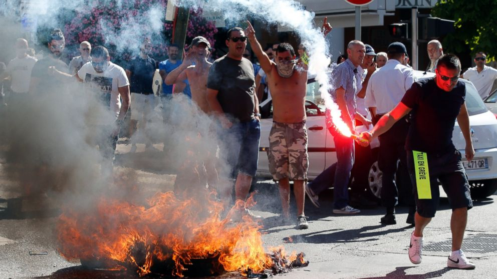 Taxi drivers on strike burn tires during a national protest against car-sharing service Uber in Marseille, France, June 25, 2015.