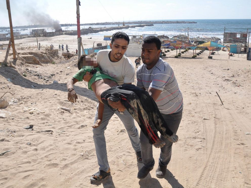 PHOTO: Palestinians carry the body of a boy whom medics said was killed by in Gaza City