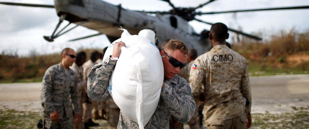 PHOTO: A soldier carries relief aid after Hurricane Matthew passes in Jeremie, Haiti, Oct. 9, 2016.