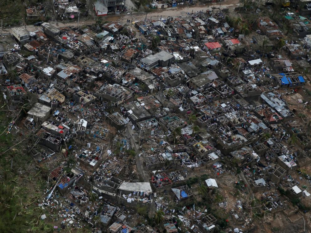 PHOTO: People walk around near destroyed houses after Hurricane Matthew passes Jeremie, Haiti, Oct. 5, 2016.