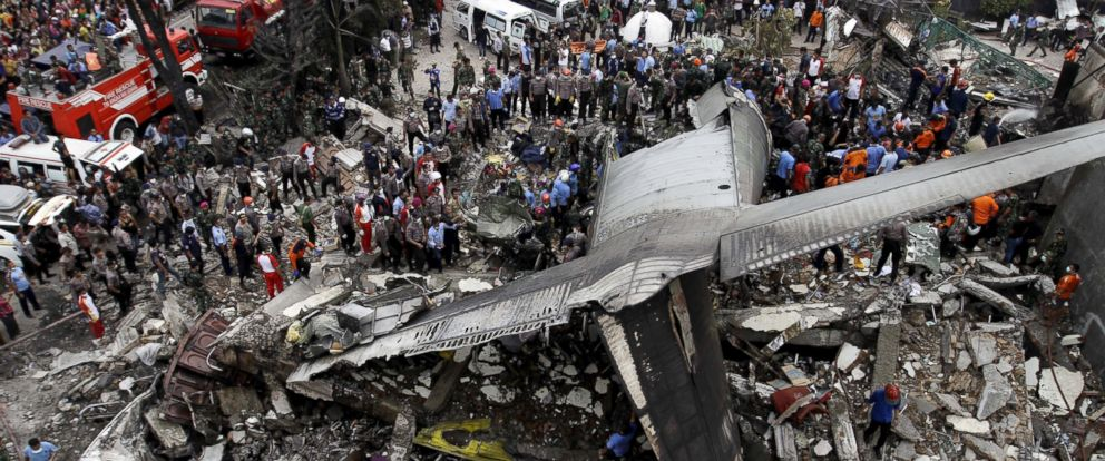 PHOTO: Security forces and rescue teams inspect the site where an Air Force cargo plane crashed in Medan, North Sumatra, Indonesia, June 30, 2015.