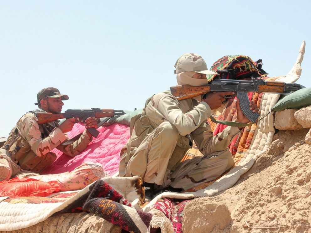 PHOTO: Iraqi security forces and volunteers take part in a mission to secure an area