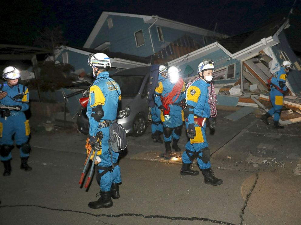 PHOTO: Police officers check a collapsed house after an earthquake in Mashiki town, Kumamoto, Japan, April 16, 2016.