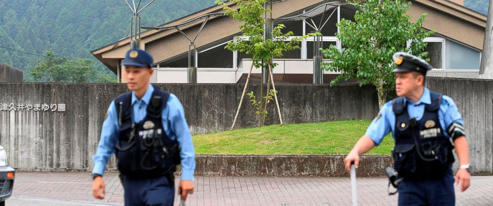 PHOTO: Police officers are seen in front of a facility for the disabled where multiple people were killed and many more wounded by a knife-wielding man, in Sagamihara, Kanagawa prefecture, Japan, July 26, 2016.