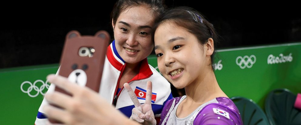 PHOTO: Lee Eun-Ju, right, of South Korea, takes a selfie picture with Hong Un Jong of North Korea.