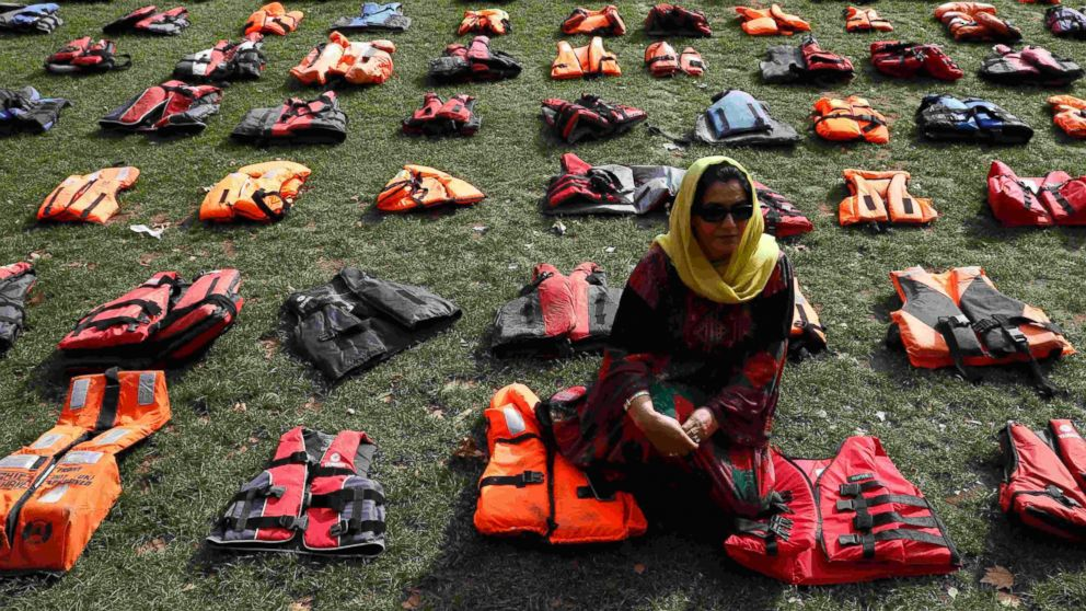 2500 lifejackets worn by refugees during their crossing from Turkey to the Greek island of Chois are seen in Parliament Square in London, Sept. 19, 2016.