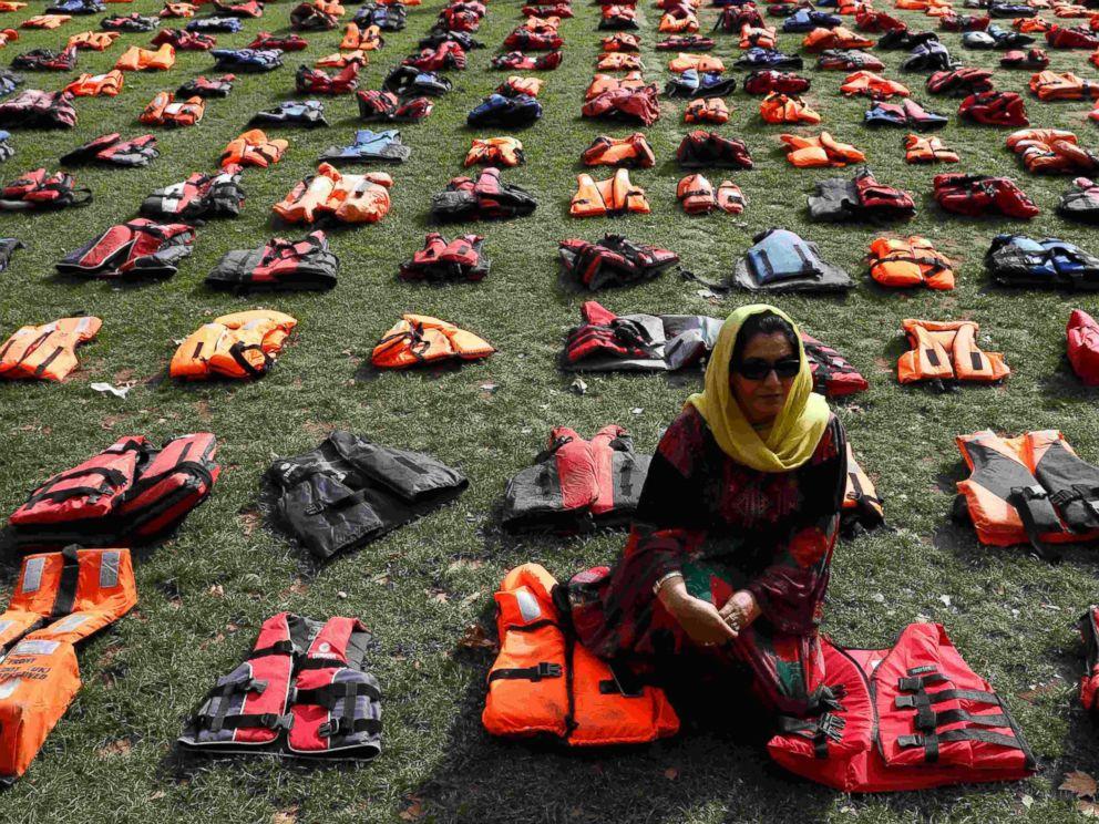 PHOTO: 2500 lifejackets worn by refugees during their crossing from Turkey to the Greek island of Chois are seen in Parliament Square in London, Sept. 19, 2016.