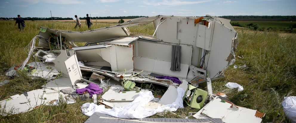 PHOTO: Parts of the wreckage are seen at a crash site of the Malaysia Airlines Flight MH17 near the village of Hrabove (Grabovo), Ukraine, July 21, 2014.