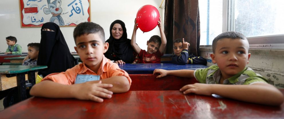 PHOTO: Palestinian refugee mothers attend with their sons their first day of the new school year at one of the UNRWA schools at a Palestinian refugee camp al Wehdat, in Amman, Jordan, Sept. 1, 2016.