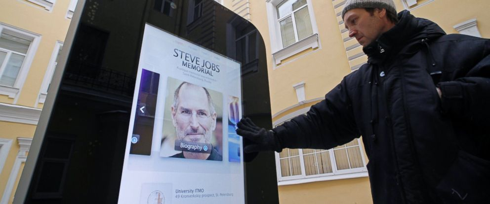 PHOTO: A man looks at a recently erected iPhone-shaped monument in memory of Apples late co-founder Steve Jobs in the yard of the State University of Information Technologies, Mechanics and Optics in St. Petersburg, Jan. 10, 2013.