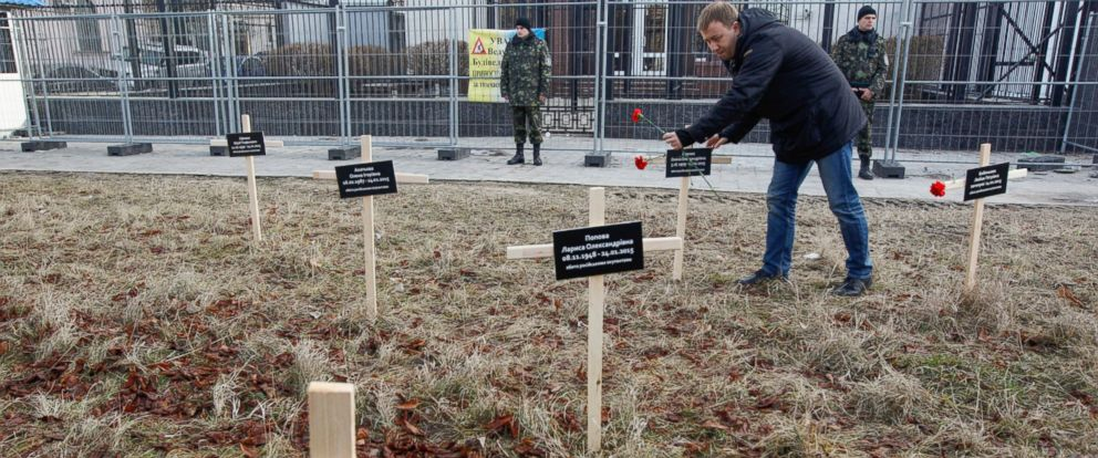 PHOTO: An activist places a cross with the name of a victim who was killed in shelling of the government-held port in Kiev, Feb. 1, 2015.