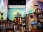 PHOTO: A child looks out from the window of his home painted with graffiti by members of OPNI, in reference to the 2014 World Cup, in the Vila Flavia slum of Sao Paulo, May 28, 2014.