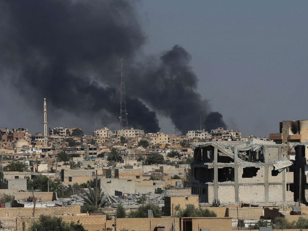 PHOTO: Black smoke rises from Raqqa city where U.S.-backed Syrian Democratic Forces fighters battle against the Islamic State militants, in Raqqa, northeast Syria, July 27, 2017.