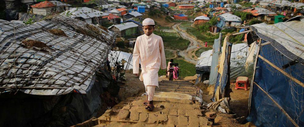 PHOTO: A Rohingya boy walks toward a makeshift mosque to offer Eid al-Adha prayers at Kutupalong refugee camp, Bangladesh, Aug. 22, 2018.