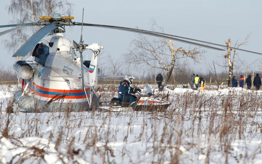 PHOTO: Russian Emergency Situations Ministry employees and Russian police officers work at the scene of a AN-148 plane crash in Stepanovskoye village, about 40 kilometers (25 miles) from the Domodedovo airport, Russia, on Feb. 12, 2018.