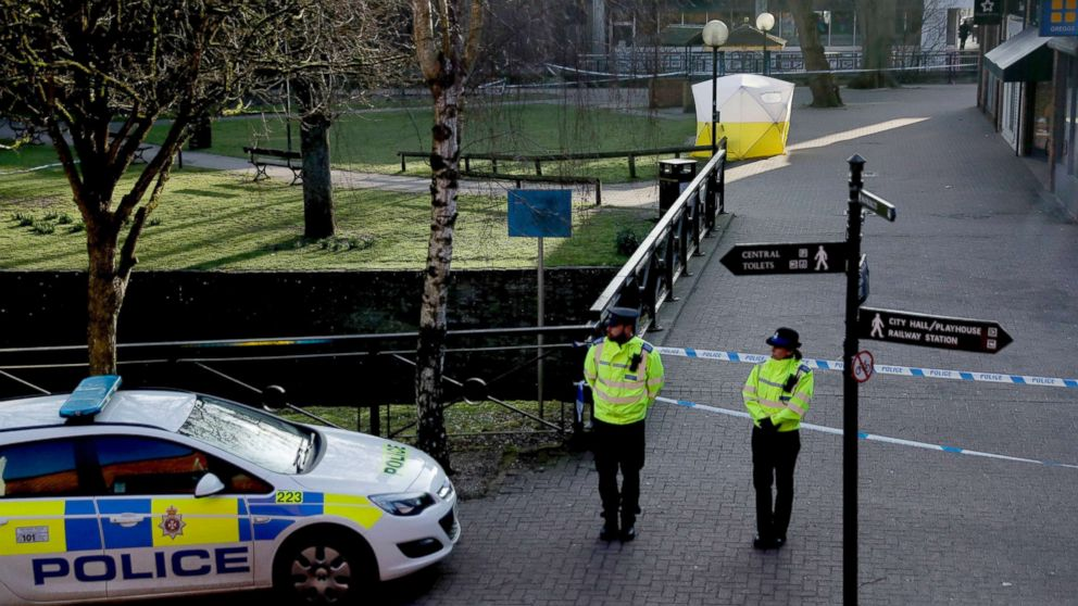 "Police officers guard a cordon around a police tent covering the the spot where former Russian double agent Sergei Skripal and his daughter were found critically ill following exposure to an ""unknown substance"" in Salisbury, England, March 7, 2018."