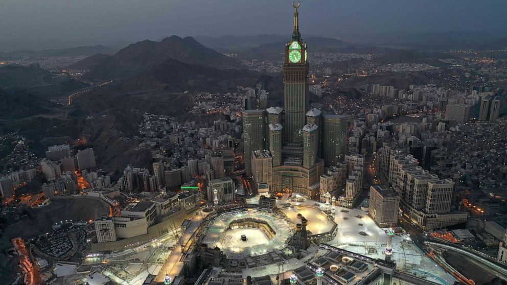 An aerial view of Saudi Arabia's holy city of Mecca, with the Abraj al-Bait Mecca Royal Clock Tower overlooking the Grand Mosque and Kaaba in the center, May 24, 2020.