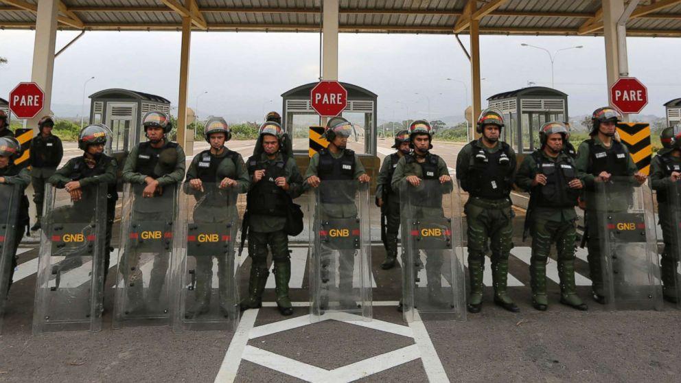 Humanitarian aid for Venezuelans stored at bridge crossing border as military blocks passage thumbnail