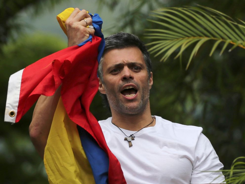 PHOTO: Venezuelas opposition leader Leopoldo Lopez holds a national flag as he greets supporters outside his home in Caracas, Venezuela, July 8, 2017.