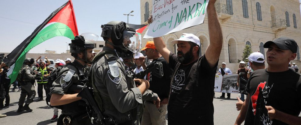 A man holding anti-Eurovision banner confronts an Israeli border policeman as Palestinian marked the 71st anniversary of their mass displacement during the 1948 war around Israels creation. Demonstrations were held across the Israeli-occupied West B