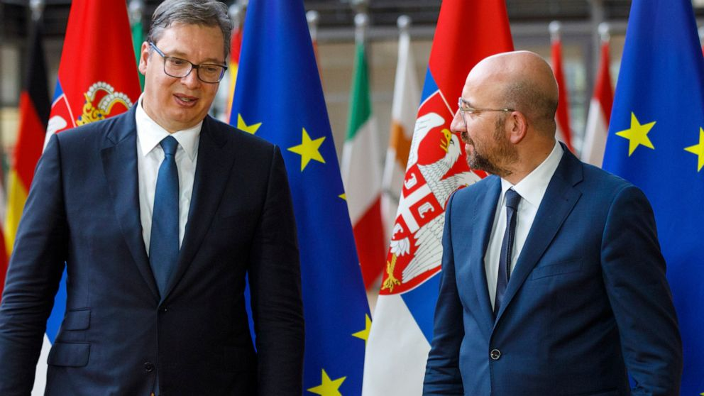 FILE - In this Friday, June 26, 2020 file photo, European Council President Charles Michel, right, greets Serbian President Aleksandar Vucic prior to a meeting at the European Council building in Brussels. The leaders of Serbia and Kosovo committed M