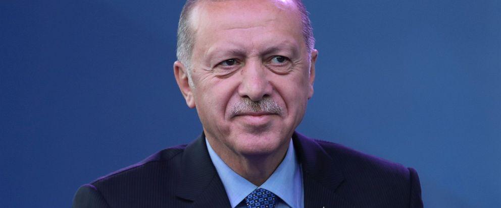 Turkeys President Recep Tayyip Erdogan acknowledges the audience during a ceremony to inaugurate a Turkey-financed highway linking Belgrade with Bosnias capital of Sarajevo in Sremska Raca, some 80 kilometers (49 miles) west of Belgrade, Serbia, du
