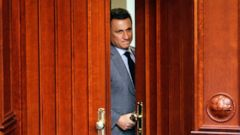 FILE - In this photo dated April 6, 2017, the former Macedonian Prime Minister Nikola Gruevski looks through an open door during a session of the parliament in Skopje, Macedonia. A Budapest court said Thursday June 27, 2019, it has rejected an extrad