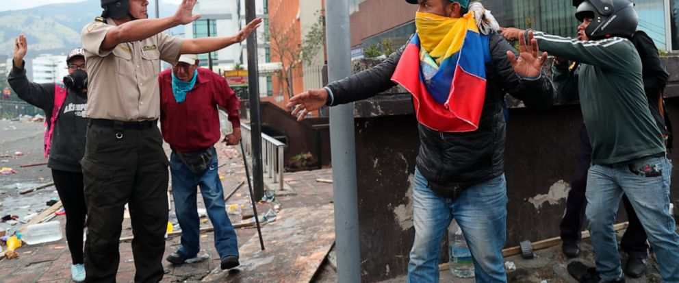 Anti-government protesters abandon their position near the National Assembly after security forces launched tear gas to disperse them, in Quito, Ecuador, Friday, Oct. 11, 2019. Hundreds more indigenous protesters poured into Ecuadors capital from th