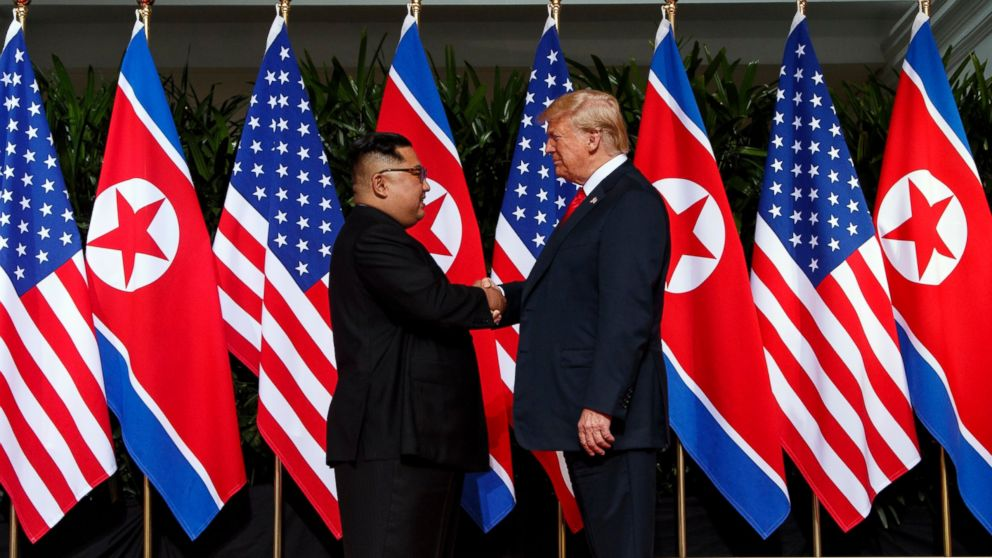 FILE - In this June 12, 2018, file photo, North Korean leader Kim Jong Un, left, and U.S. President Donald Trump shake hands prior to their meeting on Sentosa Island in Singapore. Kim Jong Un will be keeping North Korea watchers busy on New Year's Day, when he is expected to give his annual speech laying out the country's top priorities for the year ahead. Kim has a lot to talk about, like the future of his nukes, what he might want to get out of a second summit with President Trump and what's next in his peace offensive with the South. (AP Photo/Evan Vucci, File)