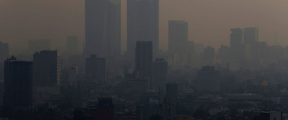 Smoke hangs over in Mexico City, Monday, May 13, 2019. Mexico Citys government has warned residents to remain indoors as forest and brush fires carpeted the metropolis in a smoky haze that has alarmed even many of those accustomed to living with air